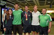 13 July 2015; The Ireland athletics squad of, from left, Ciara Everard, Adam McMullen, Thomas Barr, Kevin Batt and Neil Martin, team manager, pictured in Dublin Airport on their arrival home from the World University Games in Gwangju South Korea. Dublin Airport, Dublin. Picture credit: Piaras Ó Mídheach / SPORTSFILE