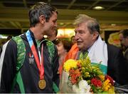 13 July 2015; Ireland's Thomas Barr pictured with Ferrybank AC founder Andy Hallissey in Dublin Airport on his arrival home from the World University Games in Gwangju South Korea. Dublin Airport, Dublin. Picture credit: Piaras Ó Mídheach / SPORTSFILE