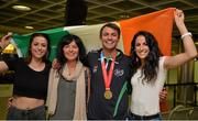13 July 2015; Ireland's Thomas Barr pictured with his sisters Becky, left, and Jessie, right and his mother Martina in Dublin Airport on his arrival home from the World University Games in Gwangju South Korea. Dublin Airport, Dublin. Picture credit: Piaras Ó Mídheach / SPORTSFILE