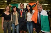 13 July 2015; Ireland's Thomas Barr pictured with his sisters Becky, left, Jessie, his mother Martina, second from left, and Ferrybank AC founder Andy Hallissey in Dublin Airport on his arrival home from the World University Games in Gwangju South Korea. Dublin Airport, Dublin. Picture credit: Piaras Ó Mídheach / SPORTSFILE