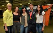 13 July 2015; Ireland's Thomas Barr pictured with, from left, Hayley Harrison, coach, Becky, sister, Martina, mother, and Jessie, sister, in Dublin Airport on his arrival home from the World University Games in Gwangju South Korea. Dublin Airport, Dublin. Picture credit: Piaras Ó Mídheach / SPORTSFILE