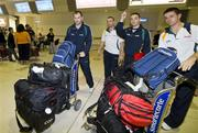 19 October 2008; Ireland's, from left, Stephen McDonnell, Paddy Bradley, Fergal McGill, GAA Operations Manager, and Aidan O'Mahony arrive at Perth Airport for the 2008 International Rules tour. Perth, Australia. Picture credit: Tony McDonough / SPORTSFILE