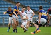 18 July 2015; Colm Cavanagh, Tyrone, in action against Michael Quinlivan and Brian Fox, left, Tipperary. GAA Football All-Ireland Senior Championship, Round 3B, Tipperary v Tyrone. Semple Stadium, Thurles, Co. Tipperary. Picture credit: Diarmuid Greene / SPORTSFILE