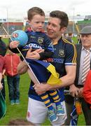 18 July 2015; Tyrone captain Sean Cavanagh, wearing Tipperary goalkeeper Evan Comerford's jersey, with Tyrone and Tipperary supporter Michéal Kirwan, aged 4, from Pomeroy, Co. Tyrone, after the game. GAA Football All-Ireland Senior Championship, Round 3B, Tipperary v Tyrone. Semple Stadium, Thurles, Co. Tipperary. Picture credit: Diarmuid Greene / SPORTSFILE