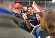 18 July 2015; Tyrone captain Sean Cavanagh, wearing Tipperary goalkeeper Evan Comerford's jersey, gets his photograph taken with supporters after the game. GAA Football All-Ireland Senior Championship, Round 3B, Tipperary v Tyrone. Semple Stadium, Thurles, Co. Tipperary. Picture credit: Diarmuid Greene / SPORTSFILE