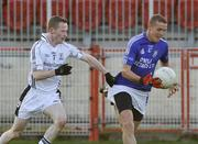 26 October 2008; Paddy Montague, Dromore, in action against Gary Coney, Clonoe. Tyrone Senior Football Final, Dromore v Clonoe, Healy Park, Omagh, Co. Tyrone. Picture credit: Michael Cullen / SPORTSFILE