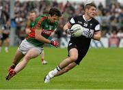 19 July 2015; Brian Curran, Sligo, in action against Ger Cafferkey, Mayo. Connacht GAA Football Senior Championship Final, Mayo v Sligo, Dr. Hyde Park, Roscommon. Picture credit: David Maher / SPORTSFILE