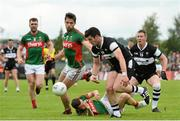 19 July 2015; Pat Hughes, Sligo, in action against Ger Cafferkey, Mayo. Connacht GAA Football Senior Championship Final, Mayo v Sligo, Dr. Hyde Park, Roscommon. Picture credit: David Maher / SPORTSFILE