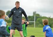 22 July 2015; Leinster rugby players Colm O'Shea and Gavin Thornbury visited the Bank of Ireland Summer Camp at Seapoint RFC to meet with young players. Pictured Gavin Thornbury tries to keep the ball from a group of camp participants. Seapoint RFC, Killiney, Co. Dublin. Picture credit: Sam Barnes / SPORTSFILE