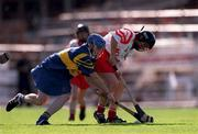 3 September 2000; Deirdre Hughes of Tipperary in action against Eithne Duggan of Cork during the All-Ireland Senior Camogie Championship Final match between Tipperary and Cork at Croke Park in Dublin. Photo by Pat Murphy/Sportsfile