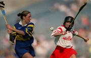 3 September 2000; Deirdre Hughes of Tipperary in action against Ursula Troy of Cork during the All-Ireland Senior Camogie Championship Final match between Tipperary and Cork at Croke Park in Dublin. Photo by Pat Murphy/Sportsfile