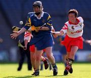 3 September 2000; Emer McDonnell of Tipperary in action against Mags Finn of Cork during the All-Ireland Senior Camogie Championship Final match between Tipperary and Cork at Croke Park in Dublin. Photo by Pat Murphy/Sportsfile