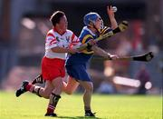 3 September 2000; Deirdre Hughes of Tipperary in action agains Mags Finn of Cork during the All-Ireland Senior Camogie Championship Final match between Tipperary and Cork at Croke Park in Dublin. Photo by Pat Murphy/Sportsfile