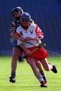 3 September 2000; Sinead O'Callaghan of Cork in action against Ciara Gaynor of Tipperary during the All-Ireland Senior Camogie Championship Final match between Tipperary and Cork at Croke Park in Dublin. Photo by Pat Murphy/Sportsfile