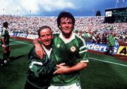 12 June 1988; Ray Houghton of Republic of Ireland celebrates with team kit man Charlie O'Leary after the UEFA European Football Championship Finals Group B match between England and Republic of Ireland at Neckarstadion in Stuttgart, Germany. Photo by Ray McManus/Sportsfile