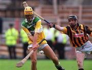 10 September 200; Ger Oakley, Offaly, in action against DJ Carey, Kilkenny. KIlkenny v Offaly, All Ireland Senior Hurling Championship Final, Croke Park, Dublin. Picture credit; Damien Eagers/SPORTSFILE