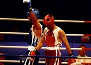 19 September 2000; Ireland's Michael Roche (right) looks dejected as Turkey's Firat Karagollu celebrates his victory in the Men's 71kg First Round. Sydney Exhibition Hall 3, Darling Harbour, Sydney, Australia. Photo by Brendan Moran/Sportsfile