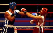 19 September 2000; Turkey's Firat Karagollu, left, lands a left to the jaw of Ireland's Michael Roche during his victory over Roche in the Men's 71kg First Round. Sydney Exhibition Hall 3, Darling Harbour, Sydney, Australia. Photo by Brendan Moran/Sportsfile
