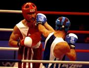19 September 2000; Ireland's Michael Roche (left) is hit with a punch by Turkey's Firat Karagollu during their bout in the Men's 71kg First Round. Sydney Exhibition Hall 3, Darling Harbour, Sydney, Australia. Photo by Brendan Moran/Sportsfile