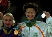 25 September 2000;  Ireland's Sonia O'Sullivan, right,  with her silver medal pictured alongside Romania's Gabriela Szabo who won Gold in the Women's 5000m Final. Stadium Australia, Sydney Olympic Park. Homebush Bay, Sydney, Australia. Photo by Brendan Moran/Sportsfile