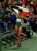 25 September 2000; Ireland's Sonia O'Sullivan celebrates with the tricolour after she won the silver in the Women's 5000m Final. Stadium Australia, Sydney Olympic Park. Homebush Bay, Sydney, Australia. Photo by Brendan Moran/Sportsfile