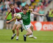 25 July 2015; Ruairi Corrigan, Fermanagh, being fouled by Ray Connellan, Westmeath. GAA Football All-Ireland Senior Championship, Round 4A, Fermanagh v Westmeath. Kingspan Breffni Park, Cavan. Picture credit: Oliver McVeigh / SPORTSFILE