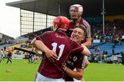26 July 2015; Galway's Tom Monaghan, 11, Fintan Burke and Jack Fitzpatrick, behind, celebrate after the match. Electric Ireland GAA Hurling All-Ireland Minor Championship, Quarter-Final, Limerick v Galway. Semple Stadium, Thurles, Co. Tipperary. Picture credit: Piaras Ó Mídheach / SPORTSFILE
