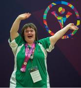 28 July 2015; Team Ireland's Lorraine Hession, a member of Team South Galway, from Turloughmore, Co Galway, celebrates after being presented with her 4th place ribbon for her swim in the AQ 100M Freestyle Division F14 event at the Uytengsu Aquatics Center. Special Olympics World Summer Games, Los Angeles, California, United States. Picture credit: Ray McManus / SPORTSFILE