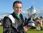 28 July 2015; Jockey Wayne Lordan with the trophy after winning the Topaz Mile Handicap on Hint Of A Tint. Galway Racing Festival, Ballybrit, Galway. Picture credit: Cody Glenn / SPORTSFILE