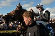 28 July 2015; Jockey Wayne Lordan celebrates in the parade ring on Hint Of A Tint after winning the Topaz Mile Handicap. Galway Racing Festival, Ballybrit, Galway. Picture credit: Cody Glenn / SPORTSFILE
