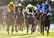 28 July 2015; Beau Satchel, with Gary Halpin up, left, races alongside Cairdiuil, with Jack Kennedy up, right, who finished second, and Beat the Ballot, with Chris Hayes up, who finished fourth, to win the Caulfield Industrial Athlone Handicap. Galway Racing Festival, Ballybrit, Galway. Picture credit: Cody Glenn / SPORTSFILE