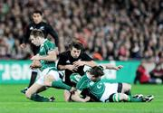 15 November 2008; Conrad Smith, New Zealand, in action against Tomas O'Leary, left, and Brian O'Driscoll, Ireland. Guinness Autumn Internationals, Ireland v New Zealand, Croke Park, Dublin. Picture credit: Stephen McCarthy / SPORTSFILE
