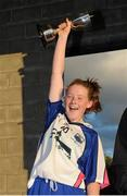 29 July 2015; Waterford Captain Chloe Fennell lifts the cup. All Ireland U16 B Ladies Football Championship Final, Roscommon v Waterford, McDonagh Park, Nenagh, Co. Tipperary. Picture credit: Seb Daly / SPORTSFILE