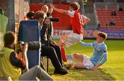 29 July 2015; Chris Forrester, St Patrick's Athletic, is sent crashing into the dug outs by Sam Tattum, Manchester City Elite Development Squad. Pre-Season Friendly, St Patrick'ss Athletic v Manchester City Elite Development Squad. Richmond Park, Dublin. Picture credit: Sam Barnes / SPORTSFILE