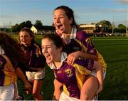 29 July 2015; Wexford's Niamh Dunne, top, and Siobhan Doolan celebrate after the game. All Ireland U16 C Ladies Football Championship Final, Leitrim v Wexford, Clane, Co. Kildare. Picture credit: Piaras Ó Mídheach / SPORTSFILE
