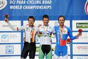 30 July 2015; Ireland's Eoghan Clifford, centre, celebrates with his Gold Medal after finishing first in the Men's C3 Time Trial. UCI Para-Cycling Road World Championships 2015. Nottwil, Switzerland. Picture credit: Jean Baptiste Benavent / SPORTSFILE
