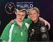 31 July 2015; Team Ireland's Ian Staunton, a member of Galway Kayaking Special Olympics Club, from Salthill, Galway, with Sgt Diana Hohman, Long Beach Police Department, at the Miami Marine Stadium, Long Beach. Special Olympics World Summer Games, Los Angeles, California, United States. Picture credit: Ray McManus / SPORTSFILE