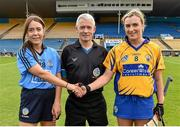 1 August 2015; Referee Cathal Egan looks on as Dublin captain Rachel Noctor and Clare captain Kate Lynch shake hands before the start of the game. Liberty Insurance Senior Camogie Championship Play-Off, Clare v Dublin. Semple Stadium, Thurles, Co. Tipperary. Picture credit: Matt Browne / SPORTSFILE