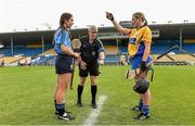 1 August 2015; Clare captain Kate Lynch chooses to play with the wind after winning the coin toss as Dublin captain Rachel Noctor and referee Cathal Egan look on. Liberty Insurance Senior Camogie Championship Play-Off, Clare v Dublin. Semple Stadium, Thurles, Co. Tipperary. Picture credit: Matt Browne / SPORTSFILE