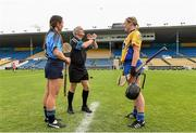 1 August 2015; Dublin captain Rachel Noctor and Clare captain Kate Lynch watch as referee Cathal Egan performs the coin toss before the start of the game. Liberty Insurance Senior Camogie Championship Play-Off, Clare v Dublin. Semple Stadium, Thurles, Co. Tipperary. Picture credit: Matt Browne / SPORTSFILE