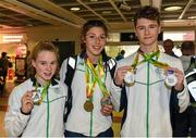 3 August 2015; Ireland swimming medallists, from left, Ellen Walsh, age 13, Temple Swimming Club, silver medallist in the 100-meter butterfly, Antoinette Neamt, age 14, Tallaght, Co. Dublin, silver and bronze medallist in the 400 and 800-meter freestyle and Conor Ferguson, age 15, Larne, silver medallist in the 100 and 200-meter backstroke, at the Irish team's return from the European Youth Olympics. Dublin Airport, Dublin. Picture credit: Cody Glenn / SPORTSFILE