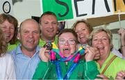 4 August 2015; Gerard, 2nd left, and Fidelma Coleman, right,  join their son Team Ireland's Sean Coleman, a member of Cork Special Olympics Swimming Club, from Youghal, Co Cork, and friends at the homecoming. Team Ireland returns from the Special Olympics World Summer Games. Terminal 2, Dublin Airport. Picture credit: Ray McManus / SPORTSFILE