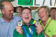 4 August 2015; Team Ireland's Sean Coleman, a member of Cork Special Olympics Swimming Club, from Youghal, Co Cork, and with his mother Fidelma and dad Gerard at the homecoming. Team Ireland returns from the Special Olympics World Summer Games. Terminal 2, Dublin Airport. Picture credit: Ray McManus / SPORTSFILE
