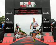 9 August 2015; Markus Thomschke, Germany, finishes second at today's inaugural IRONMAN 70.3 Dublin. Dublin City Council hosted the competition which saw over 2500 athletes complete a 1.2 mile swim in Scotsman's Bay in Dun Laoghaire, before mounting their bikes to travel through Dublin and west of the city for a 56 mile cycle, to return to the Phoenix Park for the 13.1 mile half-marathon.    1,500 Irish athletes took part in today's event and 1,000 international athletes from 40 countries travelled to Dublin to compete in the gruelling competition. Chesterfield Avenue, Phoenix Park, Dublin. Picture credit: David Maher / SPORTSFILE