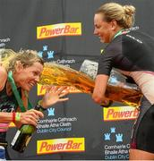 9 August 2015; Susie Cheetham, right, Great Britain, celebrates with second place Samantha Warriner, left, New Zealand, after fighting off stiff competition to take the gold medal at today's inaugural IRONMAN 70.3 Dublin. Dublin City Council hosted the competition which saw over 2500 athletes complete a 1.2 mile swim in Scotsman's Bay in Dun Laoghaire, before mounting their bikes to travel through Dublin and west of the city for a 56 mile cycle, to return to the Phoenix Park for the 13.1 mile half-marathon.    1,500 Irish athletes took part in today's event and 1,000 international athletes from 40 countries travelled to Dublin to compete in the gruelling competition. Chesterfield Avenue, Phoenix Park, Dublin. Picture credit: David Maher / SPORTSFILE
