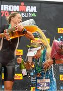 9 August 2015; Susie Cheetham, left, Great Britain, celebrates with third place Sonja Tajisich, Germany, after fighting off stiff competition to take the gold medal at today's inaugural IRONMAN 70.3 Dublin. Dublin City Council hosted the competition which saw over 2500 athletes complete a 1.2 mile swim in Scotsman's Bay in Dun Laoghaire, before mounting their bikes to travel through Dublin and west of the city for a 56 mile cycle, to return to the Phoenix Park for the 13.1 mile half-marathon.    1,500 Irish athletes took part in today's event and 1,000 international athletes from 40 countries travelled to Dublin to compete in the gruelling competition. Chesterfield Avenue, Phoenix Park, Dublin. Picture credit: David Maher / SPORTSFILE