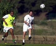 5 October 2000; Rep of Ireland's Robbie Keane and Curtis Fleming, left, in action during squad training. Training ground, National Stadium. Lisbon, Portugal. Soccer. Picture credit; David Maher/SPORTSFILE
