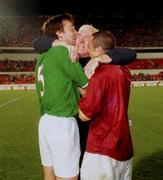 7th October 2000; Rep of Ireland physio Mick Byrne, centre, celebrates with Gary Breen and Stephen Carr at the end of the game. Portugal v Rep of Ireland. Stadium of Light, Lisbon, Portugal. Soccer. Picture credit; Damien Eagers/SPORTSFILE