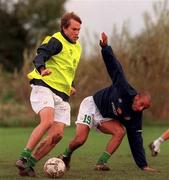 9 October 2000; Rep of Ireland's Jason McAteer in action against Curtis Fleming during squad training. AUL Complex, Clonshaugh. Soccer. Picture credit; David Maher/SPORTSFILE