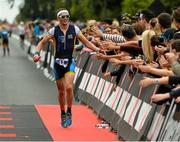 9 August 2015; Stephen Thompson, Ireland, at today's inaugural IRONMAN 70.3 Dublin. Dublin City Council hosted the competition which saw over 2500 athletes complete a 1.2 mile swim in Scotsman's Bay in Dun Laoghaire, before mounting their bikes to travel through Dublin and west of the city for a 56 mile cycle, to return to the Phoenix Park for the 13.1 mile half-marathon.    1,500 Irish athletes took part in today's event and 1,000 international athletes from 40 countries travelled to Dublin to compete in the gruelling competition. Chesterfield Avenue, Phoenix Park, Dublin. Picture credit: David Maher / SPORTSFILE